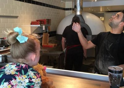 Staff throwing dough